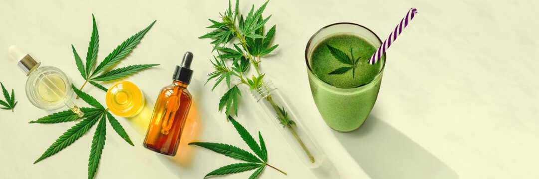 Concept edibles CBD and drinks with cannabis . Glasses with fresh beverage, smoothies, with hemp. Flat lay Banner