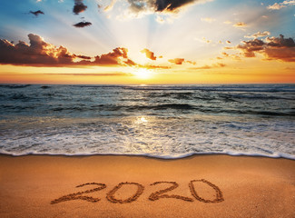 Poster Beach Happy New Year 2020! Written 2020 on the beach.