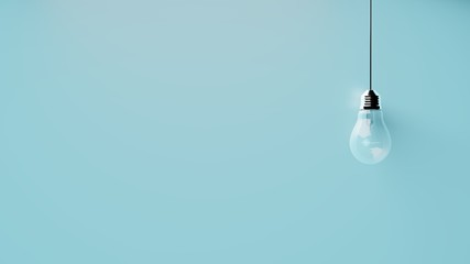 Singular hanging light bulb on bright blue background with space for text
