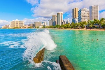 view of Waikiki Beach with the skyscrapers of Honolulu, Hawaii