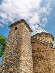 Assumption Cathedral and tower with pyramidal roof in Ananuri
