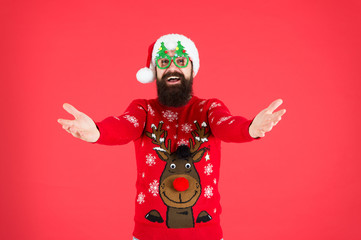 Come here. Holidays accessories. Hipster bearded man wear sweater and hat. Sweater with deer. Knitted sweater. Happy new year. Christmas spirit. Funny outfit. Clothes shop. Buy festive clothing