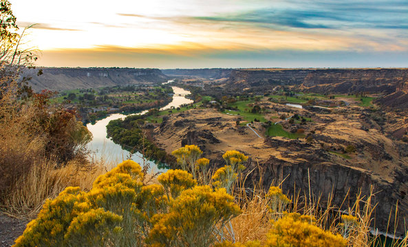 Snake river by Twin Falls at sunset with wild flowers