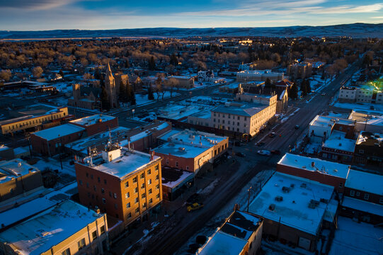 Morning Sunrise Aerial Drone View of Downtown Laramie, Wyoming in the Winter with Fresh Snow