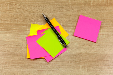 Stack of blank sticky notes with pen