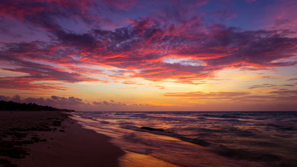 Dramatic cloudscape at sunrise at mexico caribbean beach