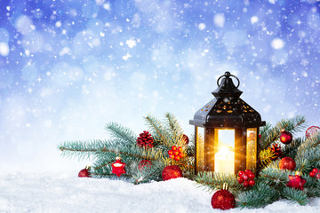 Christmas Lantern On Snow With Fir Branch and Baubles. Winter Decoration Background