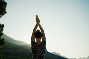 Young woman making yoga asana outside Wall mural