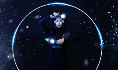 Wall Mural - Beautiful woman in futuristic dress over dark magic background. Gamer girl in glasses of virtual reality with controllers in hands. Augmented reality, game, hobby concept. VR. Blue neon light.