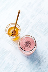 Raspberry and coconut milk smoothie with maca powder and organic honey