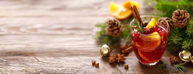 Christmas mulled wine. Traditional festive drink with decorations and fir tree. Banner with copy space.