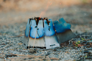 Folding wood stove for backpacking