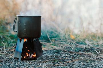 Steaming mug on folding wood stove