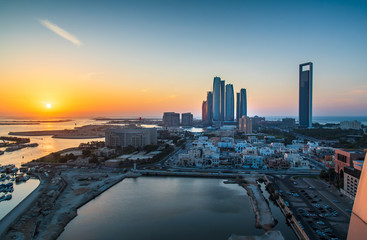 Sunset over Abu Dhabi skyline and the downtown modern buildings view