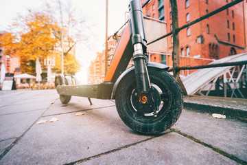 Close up of Electric kick scooter or e-scooter parked on pavement - e-mobility or micro-mobility trend. Speicherstadt, Hamburg, Germany, Europe