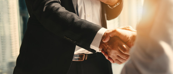 businessman handshake for teamwork of business merger and acquisition