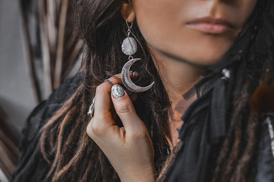 beautiful stylish woman with a lot of gem stones accessories close up portrait