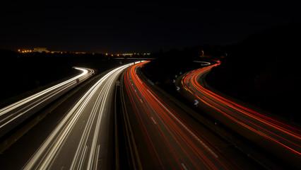 Fotorollo Nacht-Autobahn trafic routier de nuit