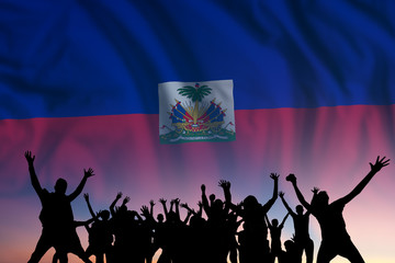 People and flag on day of Haiti