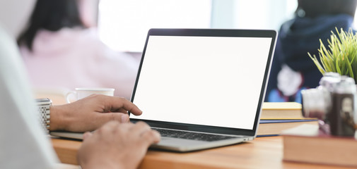 Cropped shot of businessman typing on laptop computer in comfortable workplace