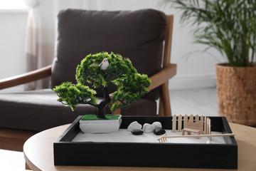 Photo sur Plexiglas Zen pierres a sable Beautiful miniature zen garden on wooden table indoors