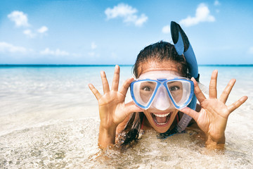 Beach vacation tourist Asian girl swimming in scuba mask making a goofy face. Snorkel fun woman on tropical travel holidays.
