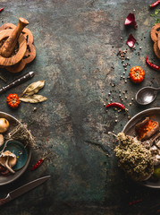 Food background with herbs and spices, top view. Frame. Dried seasoning for tasty food cooking