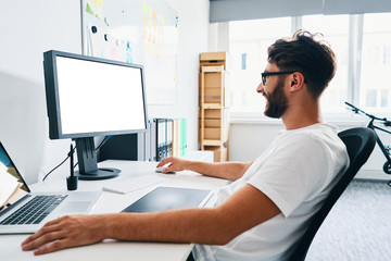 Graphic designer working on computer in office