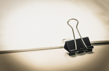 PaperClip Business reports and Accounting of documents on Office background.