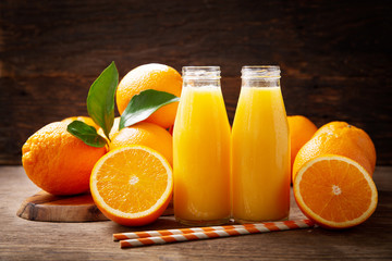 Foto op Canvas Sap bottles of fresh orange juice with fresh fruits