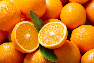 fresh orange fruits with leaves as background