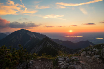 romantic sunset scenery at herzogstand mountain, view to heimgarten and hiking trail