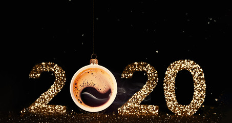 Christmas toy is made from a fragrant cup of coffee. Christmas toy. Holiday concept. Fragrant coffee on a red background for your advertising. Smoke from hot coffee. The numbers 2020 are written from