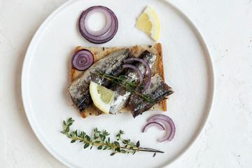 Fresh toast with fish and lemon. Fish sandwich.