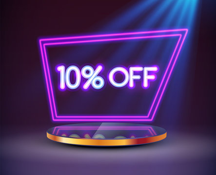 Bright neon Sale sign on round pedestal or platform with a neon frame illuminated by spotlights.