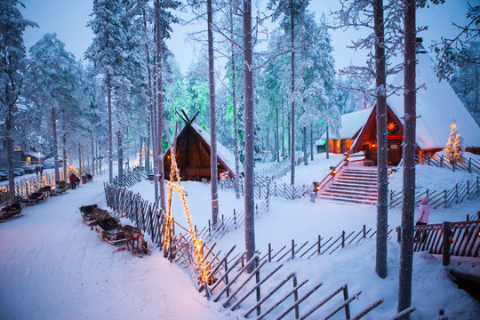 Santa claus village lapland finland. beautiful wooden bridge with lanterns