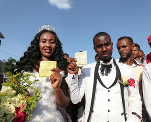 Bride Awal Beyene 22 and groom Selemawit Nega 19, show their voting cards as they celebrate their wedding ahead of Sidama region referendum vote in Hawassa