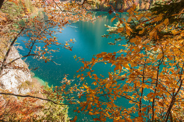 bavarian lake with colorful autumn leaves