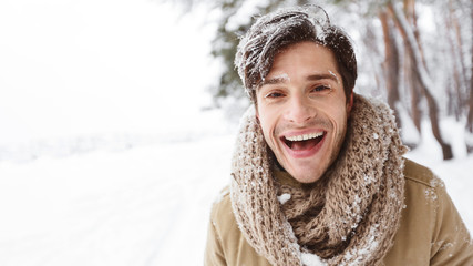 Happy Young Man Laughing Looking At Camera Enjoying Winter Outdoor