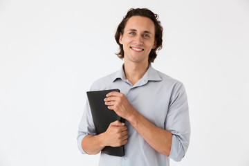Image of happy businessman in office shirt holding documents folder