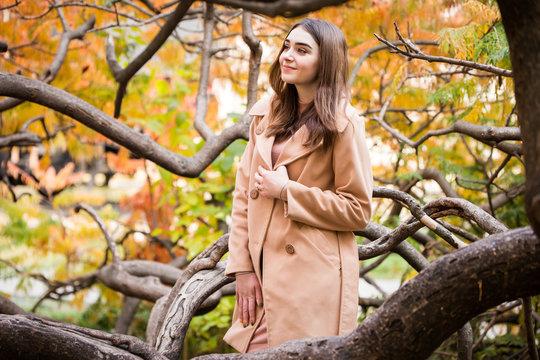 stylish woman in autumn park
