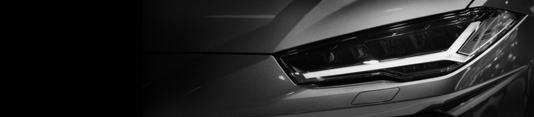 Wall Mural - Close up detail on one of the LED headlights modern car.copy space,black and white