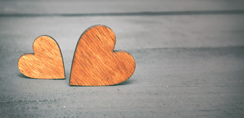 Two wooden hearts on the wooden table