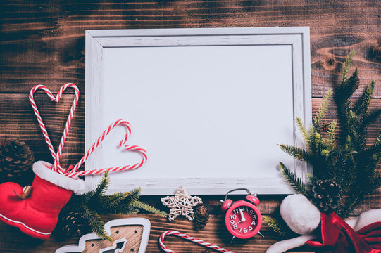 Merry Xmas and Happy New Year. Winter season holiday with Christmas decoration and photo frame background