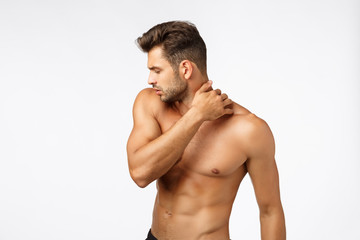 Beauty, wellbeing, workout and sports concept. Handsome sexy tanned caucasian guy with naked torso, turn away, touching neck, bodybuilder showing perfect body, standing white background