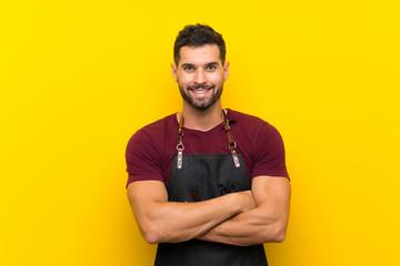 Barber man in an apron laughing - fototapety na wymiar