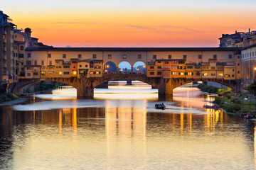 Wall Mural - Sunset view of Ponte Vecchio over Arno River in Florence, Italy. Architecture and landmark of Florence. Cityscape of Florence