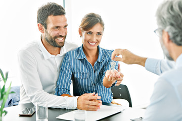 young couple new house keys buy real estate home