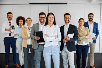 succesful business team smiling teamwork corporate office colleague