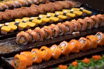 Many of sushi (Japanese food) prepare for serving customer in the restaurant.